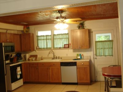 Vintage kitchen w/ microwave and dishwasher.