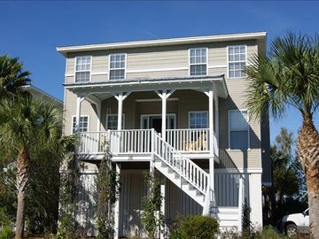 Lovely 5 BR, three story home steps from the beach in private neighborhood