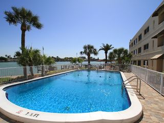 Treasure Island condo photo - Unwind in the heated pool with a spectacular bay view!