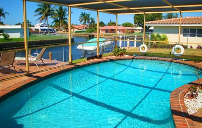 Fort Lauderdale house rental - The pool deck overlooks the waterway that connects to the ocean.