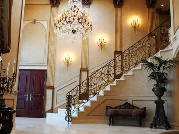 Hollywood estate rental - VIEW OF THE ENTRY AND STAIRCASE FROM THE LIVING ROOM