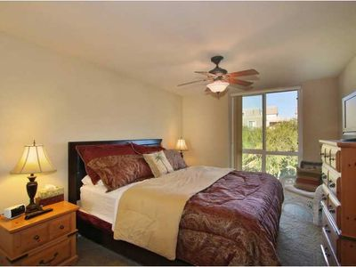 Comfortable King - sized bed. Beautiful garden view from bedroom, flatscreen TV.