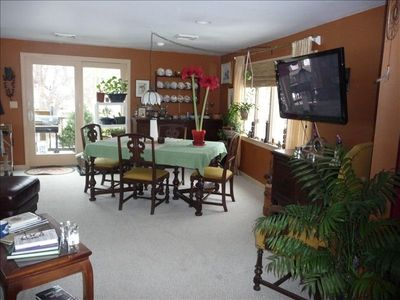 Living Room 1 showing sliders out to deck