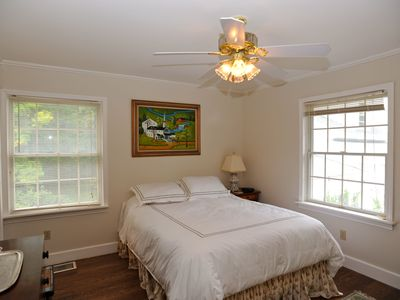 Bedroom with queen bed and view of St. Lawrence River