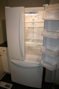Full size double door refrigerator in kitchen