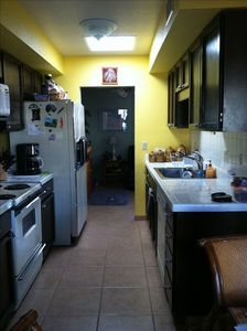 kitchen with microwave, coffee maker and fully stocked (no food)
