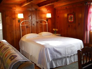 Queen size bed at Clear Creek Cabin