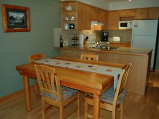 Canmore condo photo - Dining room w/ log dining table - table seats 6 (there are 2 additional chairs)
