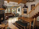 Living and Dining Area - Gas Fireplace, Deck Access, Classic Decor - Vail townhome vacation rental photo