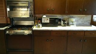 Lake Placid house photo - Galley kitchen, 2 ovens, stove & grill. Laundry room to the left.