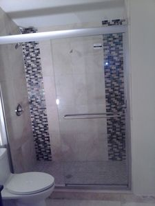 3rd floor bath, all new travertine floors and shower, new sink, toilet, lights