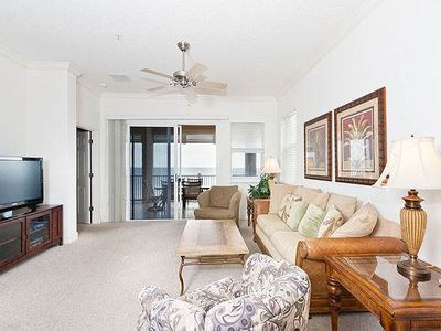 Stretch out in the bright and open living room - This casually elegant condo has ocean views, a large HDTV, and bright sunny rooms. Leave the patio doors open and listen to the surf night and day!