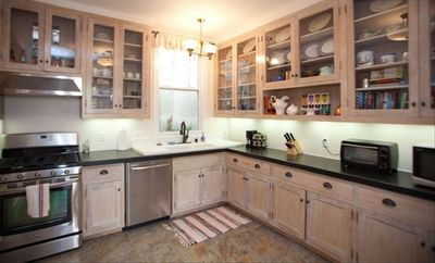 The fully stocked kitchen has a dishwasher, gas range, and washer & dryer.
