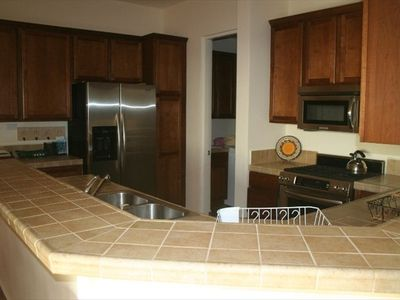 Kitchen with eating bar --stainless steel appliances and top quality utensils
