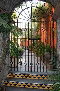 Iron gates to court yard garden