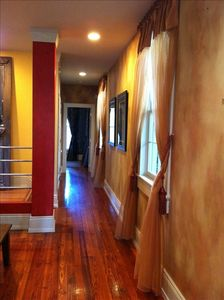 Hallway to 1st bedroom/office & staircase to 2nd floor,natural light throughout