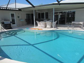 Vacation Homes in Marco Island house photo - Brand new pool cage and grill