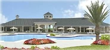 Lagoon swimming pool and clubhouse - game & fitness room inside.
