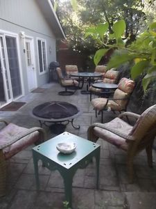 back deck with comfortable seating, patio table, fire pit and BBQ