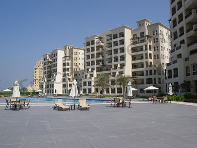 The swimming pool located next to the apartment