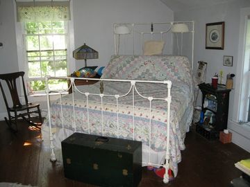 One of four large bedrooms. Lots of beautiful antiques and art at The Farm!