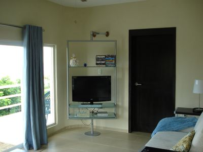 Living Room with LCD tv, DVD player, and iPod docking stereo, SIRIUS Radio too!