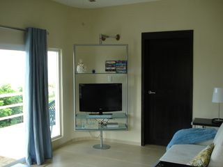 Isla Mujeres house photo - Living Room with LCD tv, DVD player, and iPod docking stereo, SIRIUS Radio too!