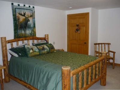 Bedrooms have comfortable pillow top log beds