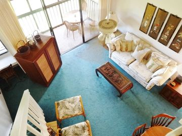 Kahuku - Turtle Bay condo rental - Loft View of Living / Dining Room. Armoire Holds 32' HDTV and XBOX 360