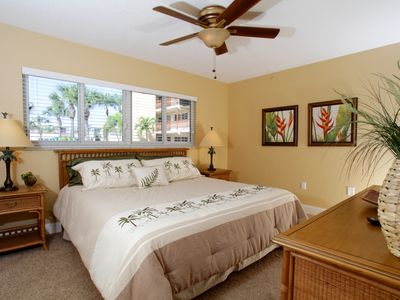 After a busy day relax in the spacious king bedroom with a bayfront water view.