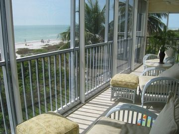 The glass/screen lanai has a direct front and side views of the Gulf & Beach!