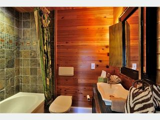 Key West house photo - The Hemingway en-suite bathroom 5: Note one-of-a-kind tub enclosure.