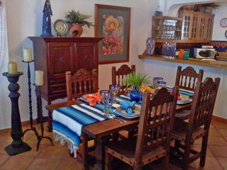 Puerto Vallarta condo photo - Elegant Dining room with bar & buffet. Home decorated in classic Mexican style.