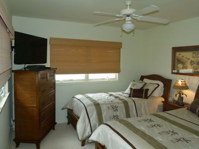 The third bedroom features 2 comfortable twin beds and HD TV.