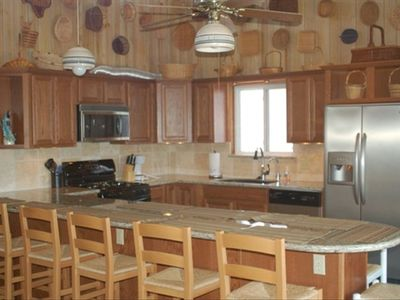 Chef's kitchen. Granite countertops, stainless appliances. Seating for 12 at bar