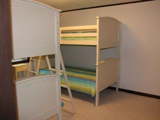 Bourne cottage photo - Second bedroom with two twin bunk beds and two closets.