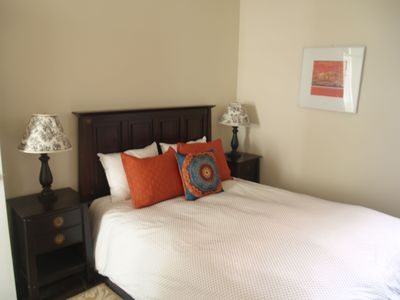 Capitol Hill house rental - 2nd bedroom with queen bed, closet, plenty of drawer space, and tv