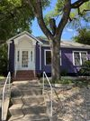 Adorable purple bungalow right on W. 6th Street!
