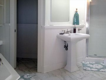 Master bath with jetted tub, private shower and dual pedestal sinks