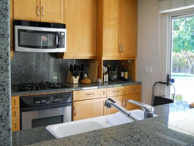 Upgraded all-the-way...granite, stainless, complete cookwear, glasswear, bargear