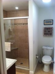 upstairs master bathroom with large luxury shower - Indian Shores condo vacation rental photo