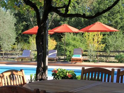 Relax with family and friends under grape arbor