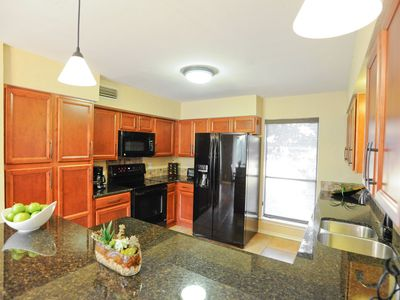 New granite countertops, cabinets and kitchen appliances