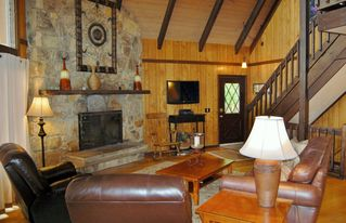 Gatlinburg chalet photo - Large open living room with wood burning fireplace, soaring ceiling & views