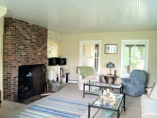 Harpswell cottage photo - Living room ~ adjacent to the porch and kitchen.