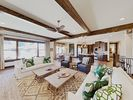 Living Area - The spacious Great Room serves as the social heart of the home, detailed with high ceilings and an open flow for entertaining.