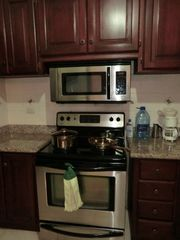 Bavaro condo photo - Kitchen stove and microwave