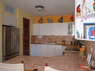 Rincon villa photo - Large open well-equipped kitchen with wrap-around island with a couple of stools