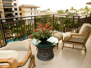Ko Olina condo photo - Lanai off Dining and Kitchen, with view over Lap Pool and out to the Pacific Oce