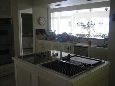 Rockport house rental - Large square kitchen with cooktop on center island & wet bar separate from sink